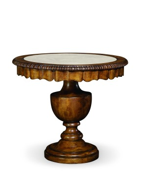 The Caperana Lamp Table from Century Furniture suggests Tudor linenfold paneling, which feels gathered and ruffled.